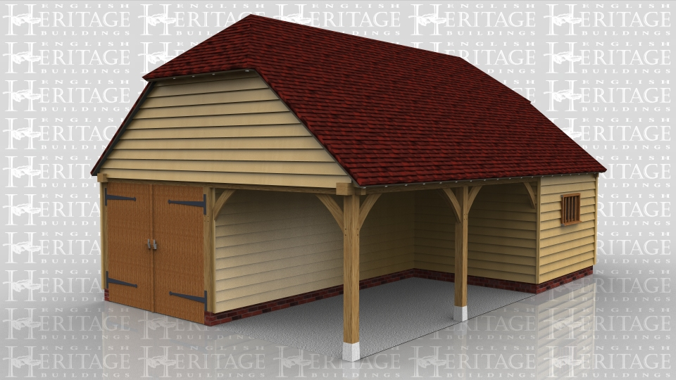 This oak framed garage has two open bays at the front and one enclosed, as well as an enclosed section to the rear, accessed by two sets of garage doors. The enclosed bays have mullion windows.