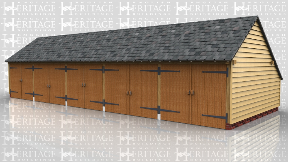 This oak framed five bay garage has five sets of garage doors and an enclosed log store to the side. The building also has an enclosed store to the rear.