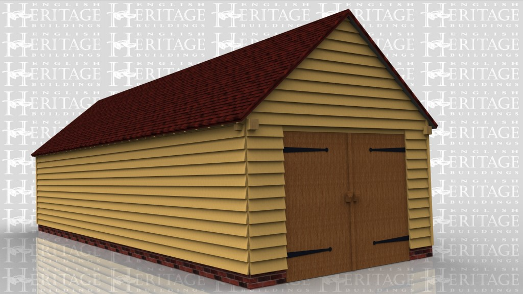 This oak framed garage building is enclosed and access is via a set of garage doors to the left hand side and a single solid door to the front. There are also two sets of three pane windows to the front and a mullion window to the right side.