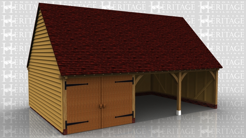 This oak framed garage is formed of three bays; one enclosed and two open. The enclosed bay is accessed via a set of garage doors to the front.