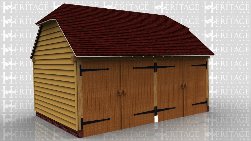This oak framed building is a two bay garage secure with garage doors and a barn hip at each end.