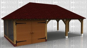 This is a three bay oak framed garage with two open bays and one enclosed bay and is secured with a pair of garage doors.