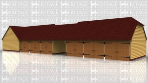 This oak framed building has nine bays. One of the bays is open. There are six sets of garage doors on the front there are two sets of garage doors on the rear of the building.