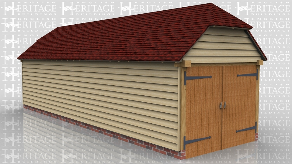 This is a one bay oak framed garage secured with a set of garage doors on each end. There is also a barn hip on each end.