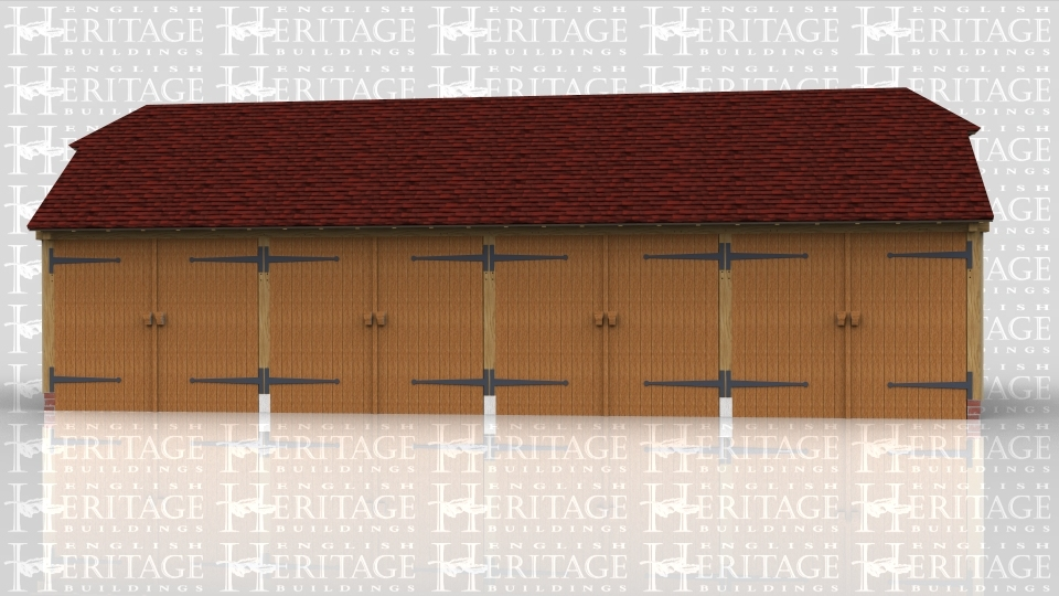 This is an oak framed four bay garage, with each bay enclosed and secured by standard garage doors.There is also an enclosed rear logstore.