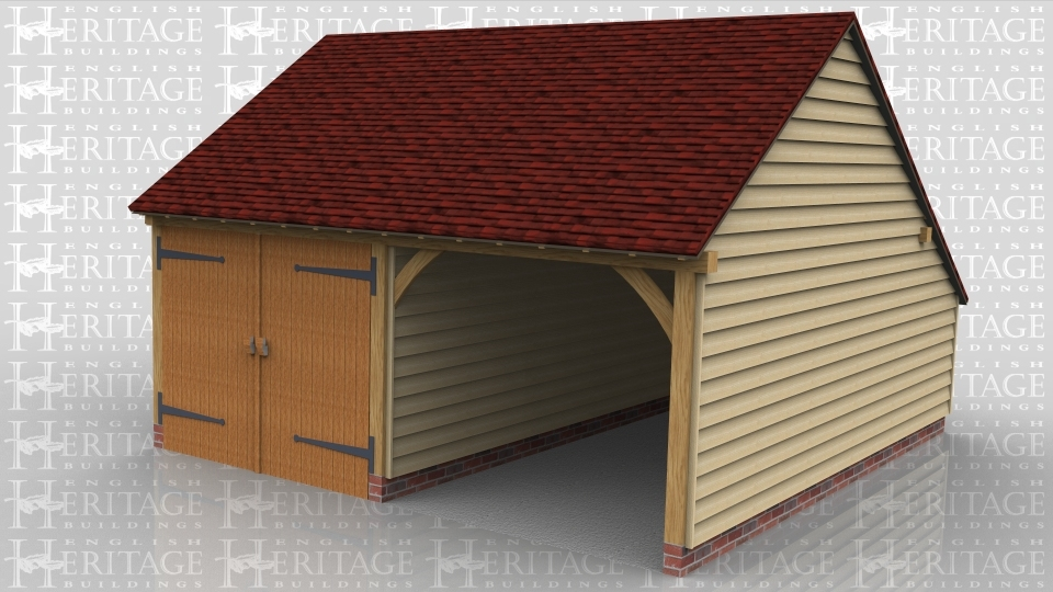 This is a two bay oak framed garage with on enclosed bay secured with a set of garage doors. There is also an enclosed store to the rear.