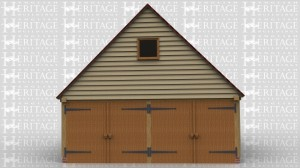 This is an oak framed two bay building with two sets of garage doors on the left hand side and one set of garage doors of the right hand side.