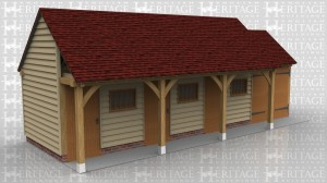 This oak framed building is comprised of two different frames. One is a three bay stable with each bay enclosed and accessed via a stable door to the front and a mullion window. The other frame is a single bay enclosed garage with standard garage doors to the front.