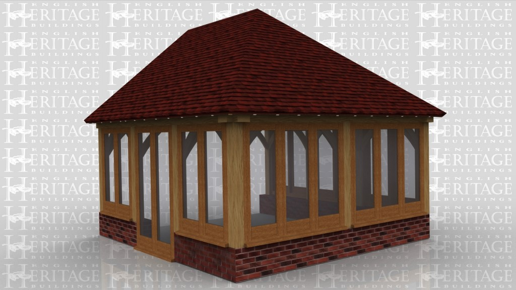 This is an oak framed building designed to be attached to an existing building.There is a pair of fully glazed french doors and the rest of the windows sit on a dwarf cavity brick wall.
