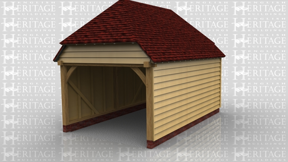 This oak framed building is a one bay garage with an open front and the rest enclosed.