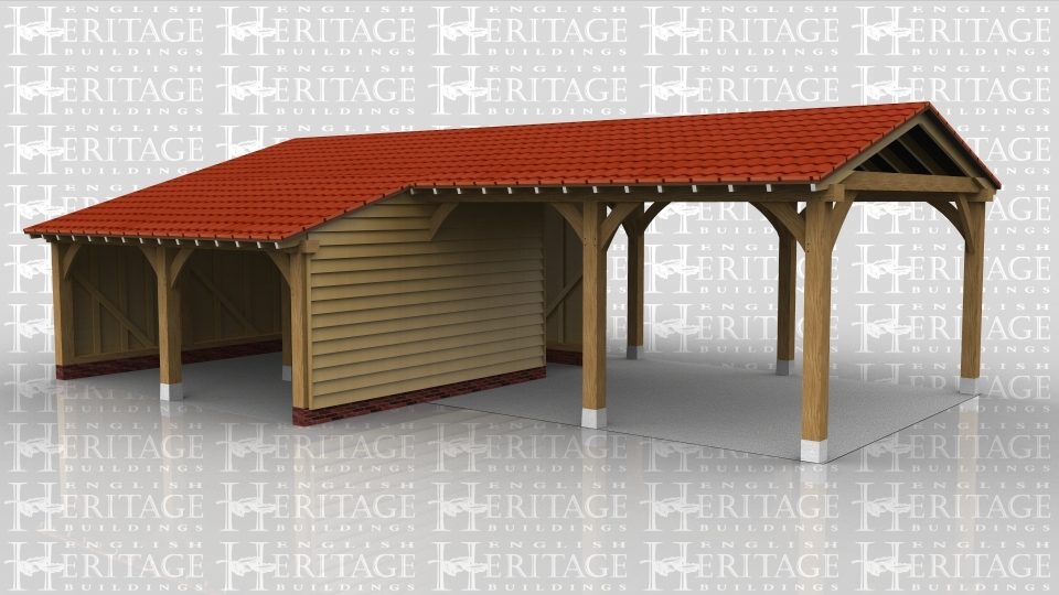 This oak framed four bay garage has two bays that are open to the front and rear and two that are enclosed with a store to the rear. The roof has a very low pitch and gable ends.