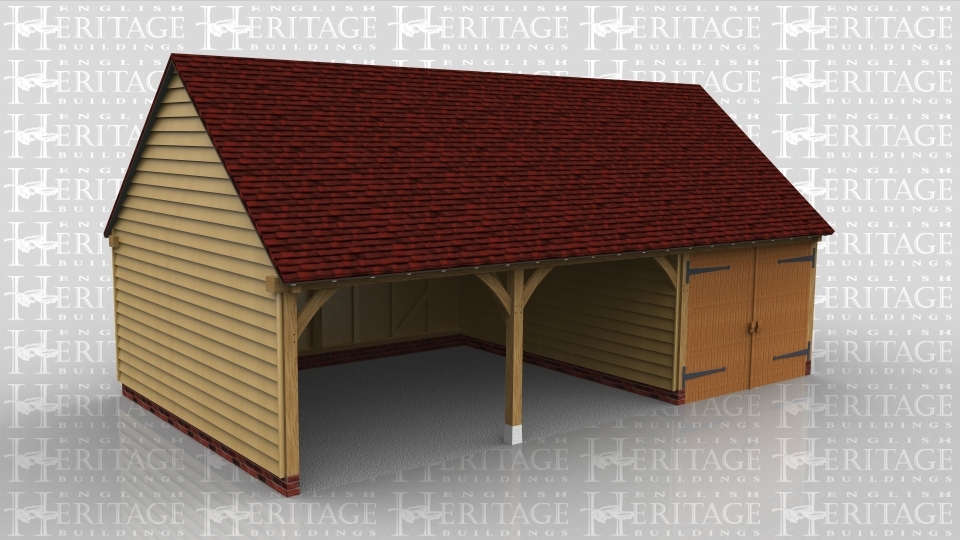 This oak framed garage building has two open bays and one enclosed. The enclosed bay is accessed via a garage door to the front of the building.