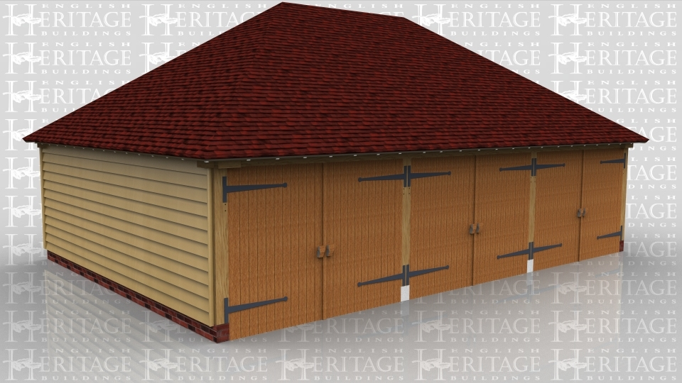 This oak framed garage building has three enclosed garage bays, each accessed by a standard garage door to the front of the building.