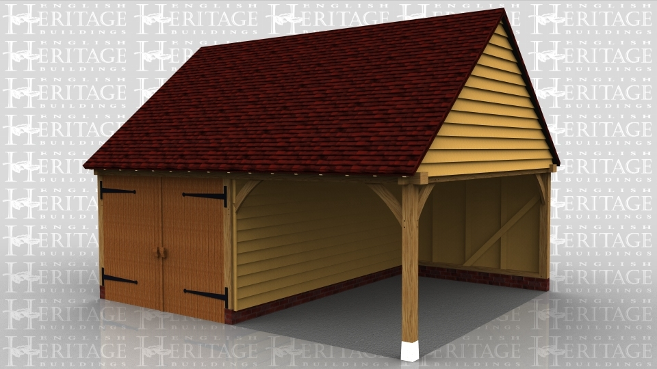 This oak framed garage has two bays, one is enclosed and accessed via a garage door to the front, and the other is open. There is a single circular window to the first floor on the right hand side.