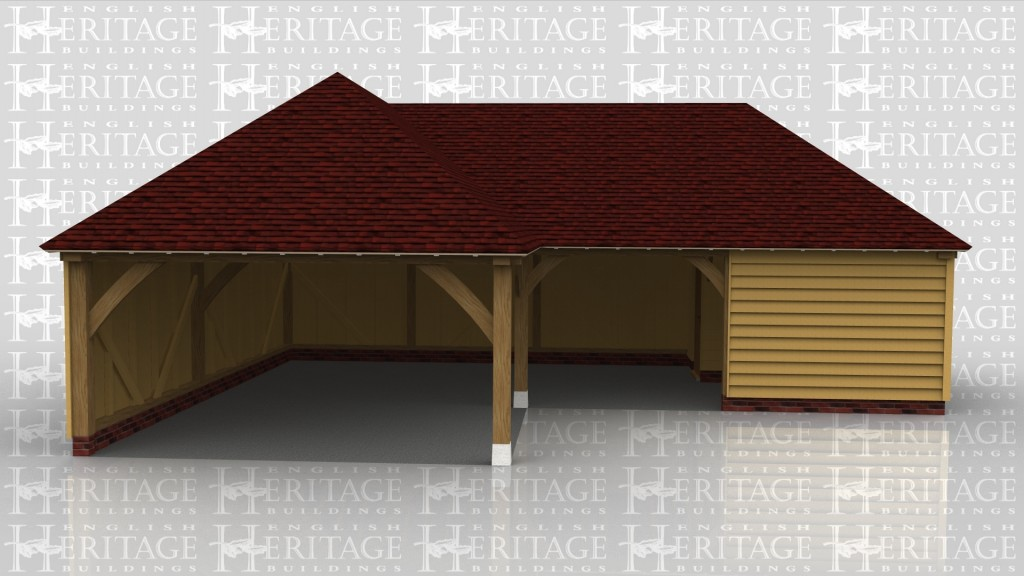 An L shaped oak framed garage. One end has a bay for parking whilst the other has a studio or storage space connected.