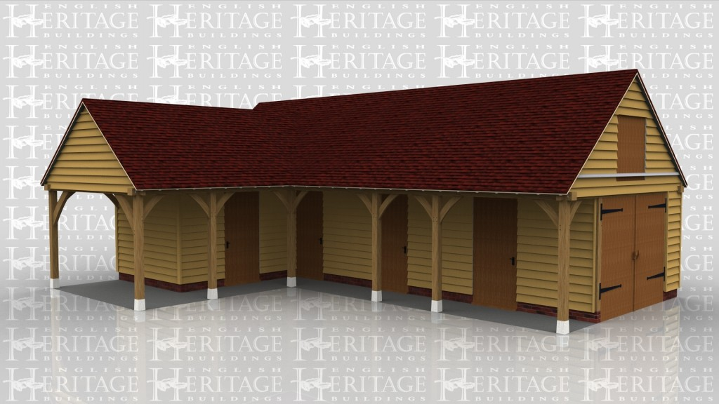 An oak frame equestrian/stable building, with hay store and shelterd roof area.