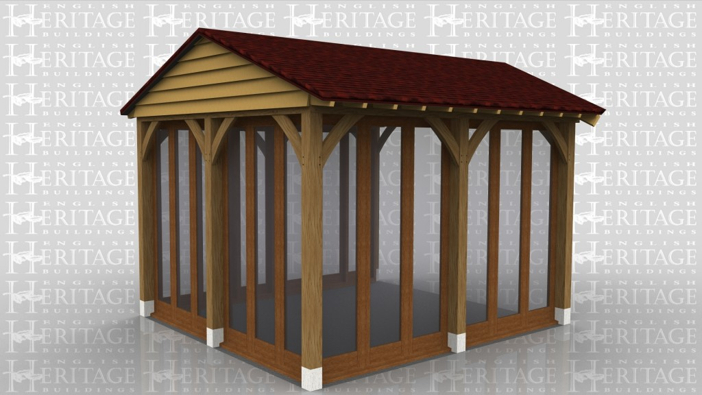 A simple oak framed house extention conservatory / garden room with full height glazing on all sides.
