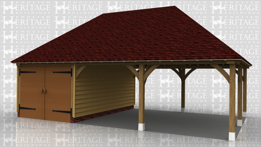 An oak framed garage / car port with 2 open bays and one enclosed secure space.
