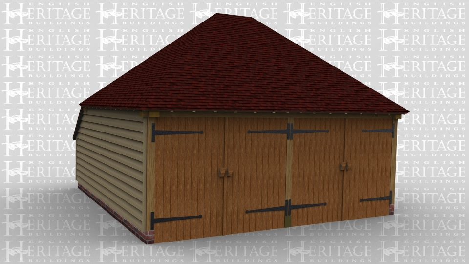 An oak framed garage with two bays secured with garage doors.