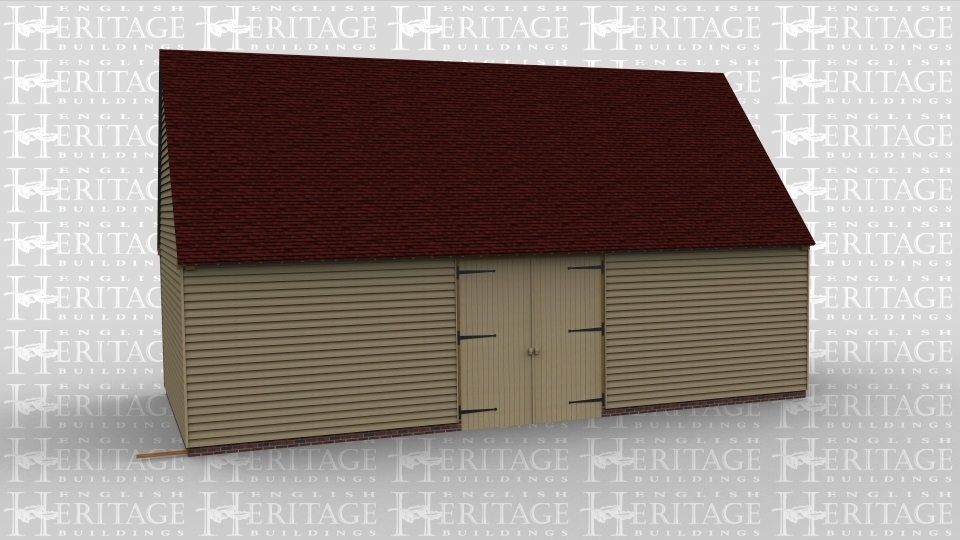 A large traditional oak frame barn building with one set of barn doors.