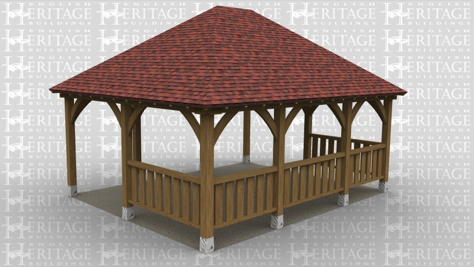 An oak framed gazebo with ballastrade.