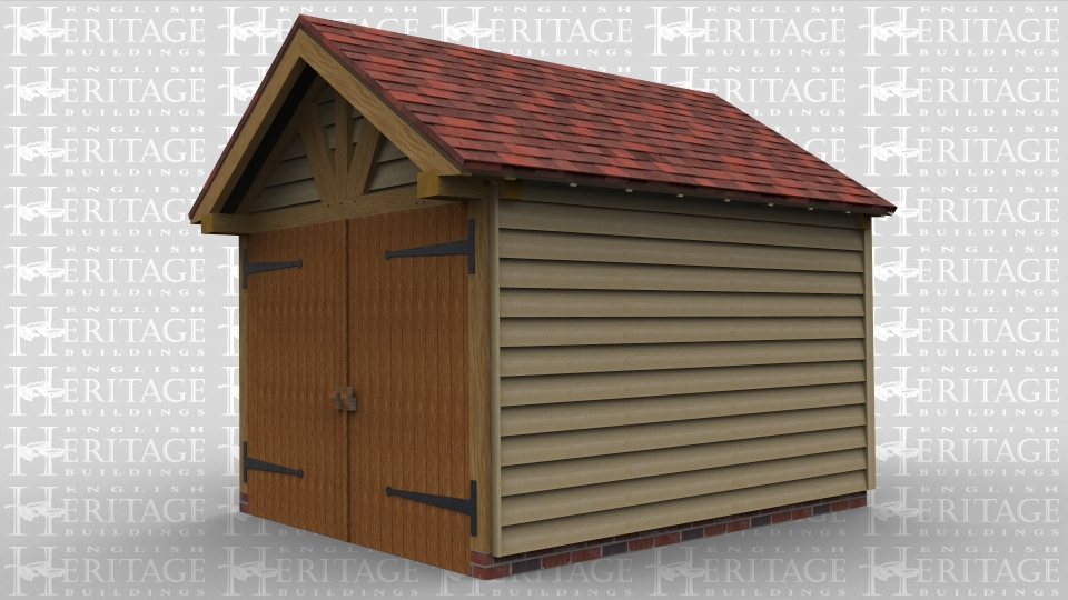 An oak framed garage with large windows, a set of barn doors and a feature truss to the front.