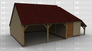 An oak framed garage with two open parking bays, with a studio/storage space next door.