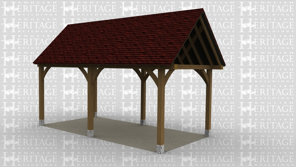 An open oak frame car port.