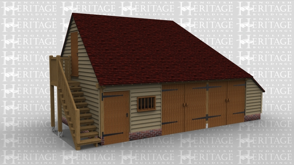 An oak frame garage, on the ground floor 2 sets of barn doors, there is also a small window on the front of the garage. The first floor is access via an external staircase and on the first floor there are 2 rooflights to allow plenty of natural light to enter the room