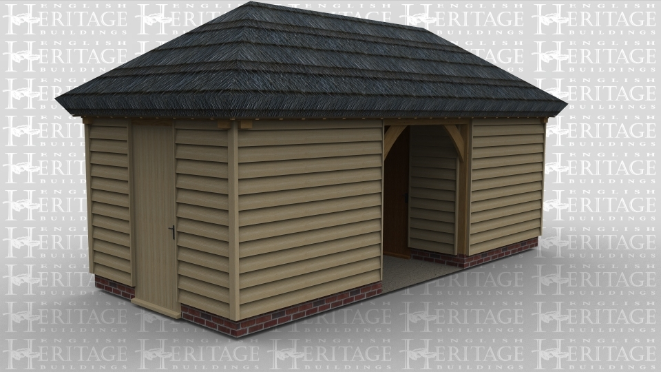 A 3 bay oak framed building with a thatched roof , it has rooms on either end an an open plan middle bay.