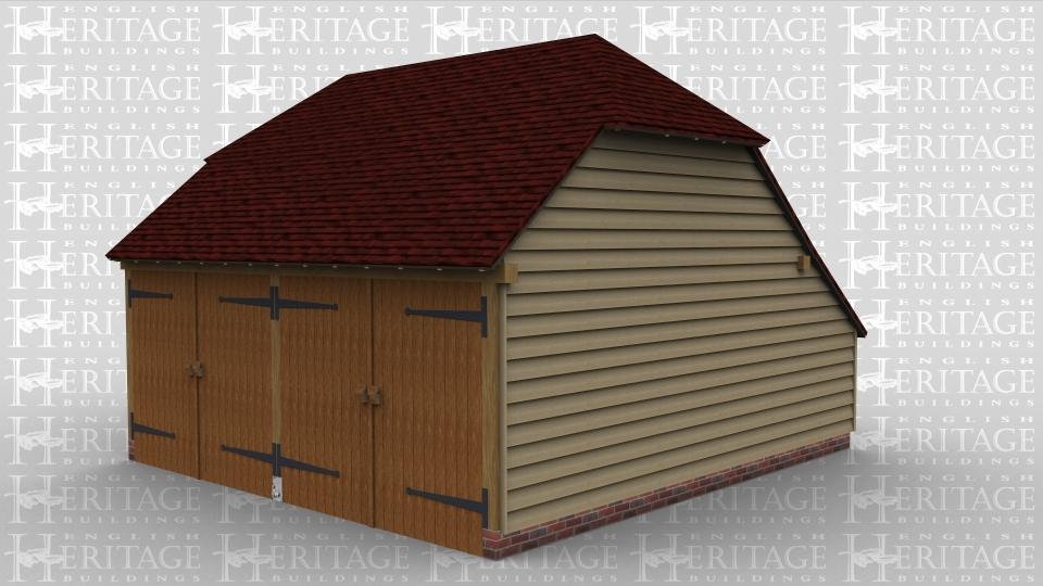 A traditional 2 bay oak frame garage with barn doors.