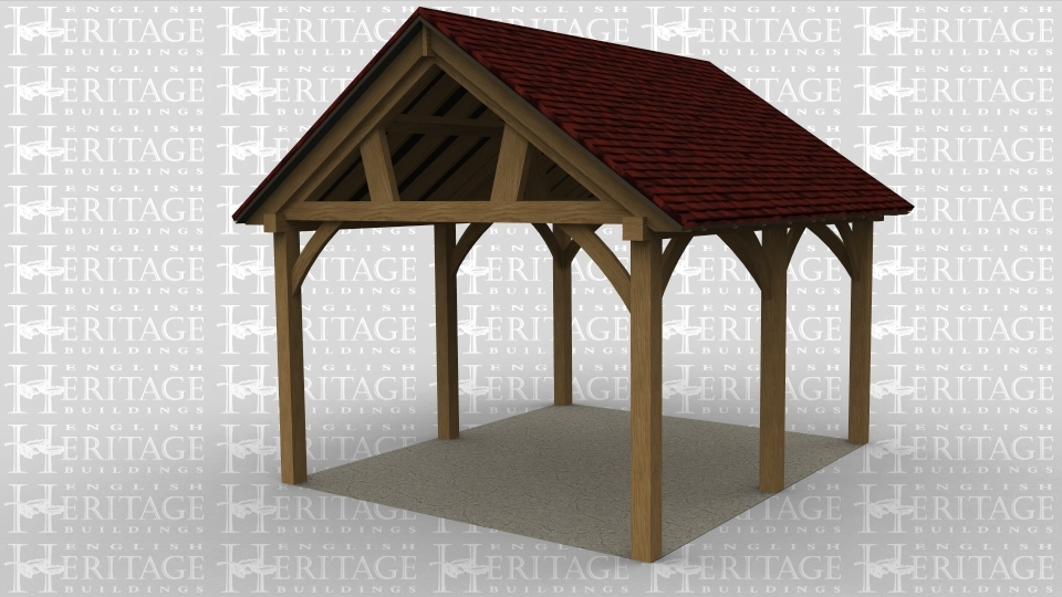 An oak framed open car port with feature trusses.