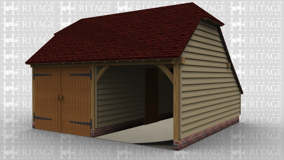 A 2 bay oak frame garage with open bay and one with large iroko barn doors with a connecting door between the two