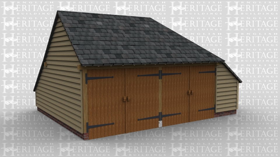 A 2 bay oak frame garage with two pairs garage doors and an enclosed aisle on the right hand side.