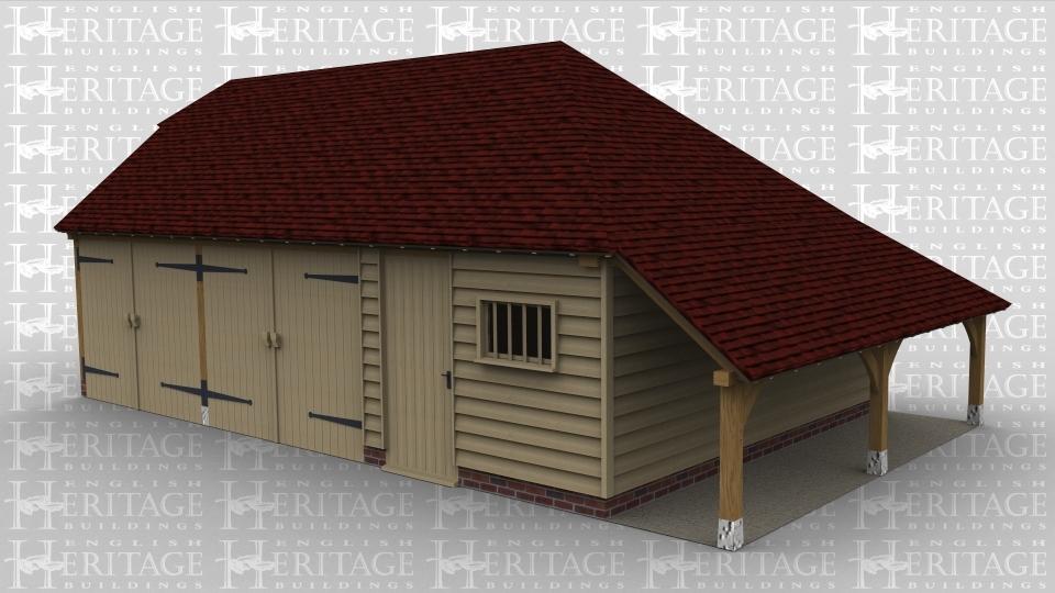 A single bay oak frame garage with large iroko doors