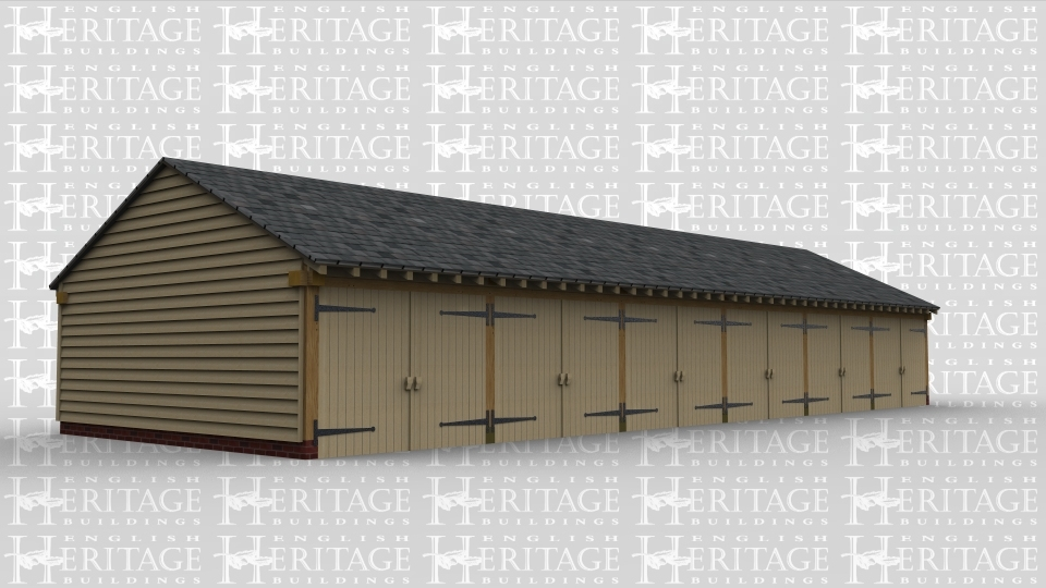 A  straight 6 bay oak frame garage with garage doors at the front of each bay.