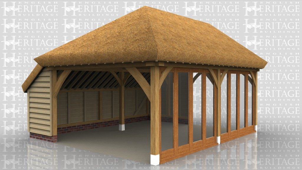 A 2 bay oak frame home extension with a thatched roof. This building has full height glazing all along the front to allow plenty of natural light in, both the left and right side are left partially open.