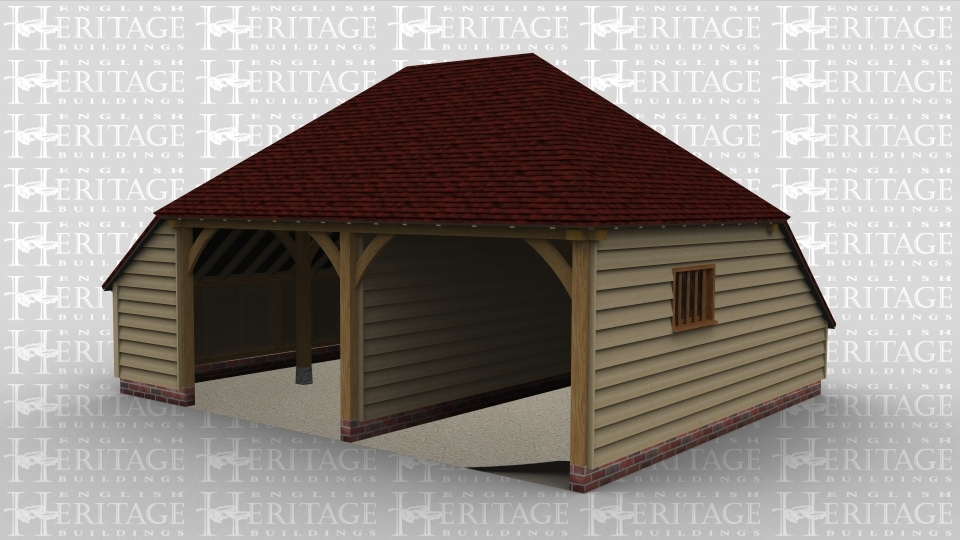 A two bay open ended oak frame garage with an internal partition between the bays and  catslides on both the left and rear of the building.