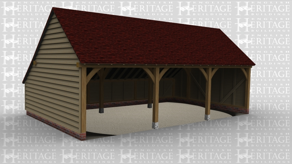 A three bay oak framed garage open at the front with a catslide at the rear.