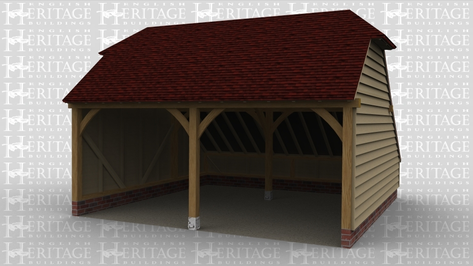 A two bay oak framed garage open at the front with barn hip style roofing on both the left and right side of the building.