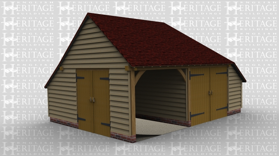 A two bay oak framed garage with one bay containing an iroko garage door at the front whilst the other bay is open at the front and has a iroko garage door on the left hand side of the building. This frame also has an internal partition between the bays and an aisle on the right hand side of the building.