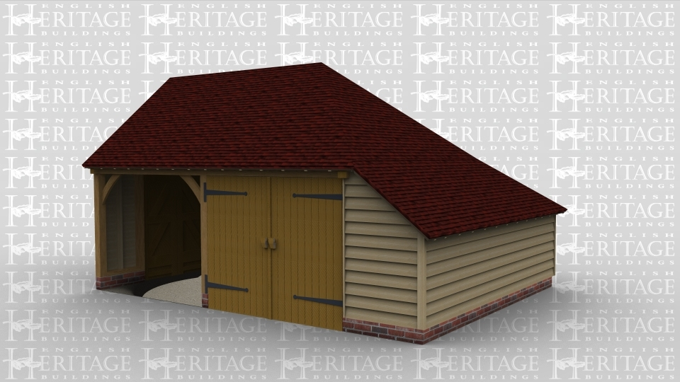A two bay oak framed garage with one bay containing a set of iroko garage doors at the front whilst the other bay remains open at the front, this building also has an internal aisle on the right side of the frame.