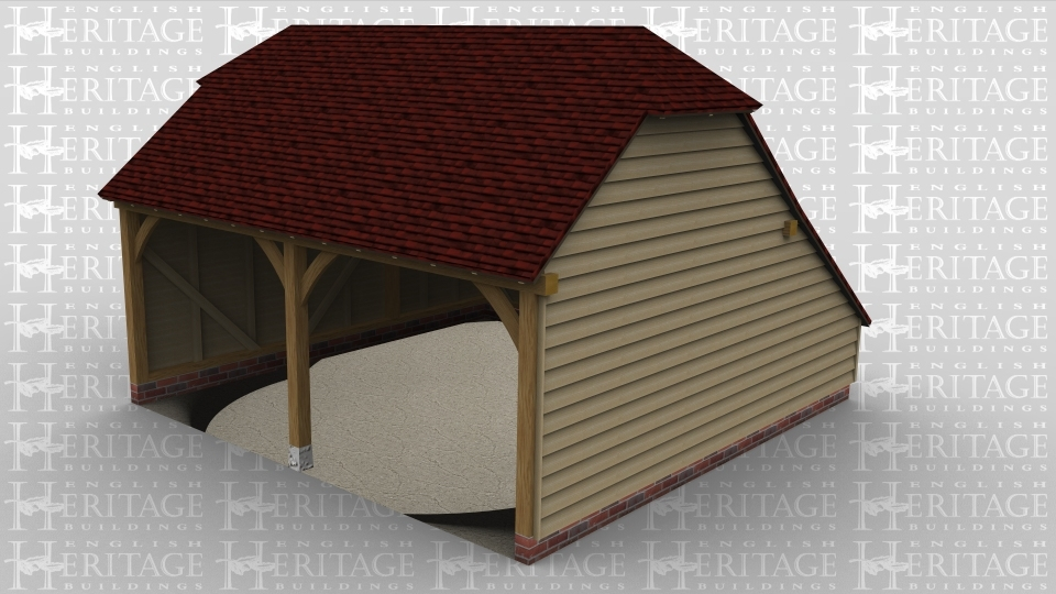 A two bay oak framed garage open at the front and has a barn hip style roof on both the left and right of the building