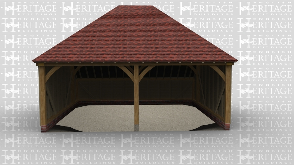 A two bay oak framed garage that is open at the front and has a full hip style roof on both the left and right side.