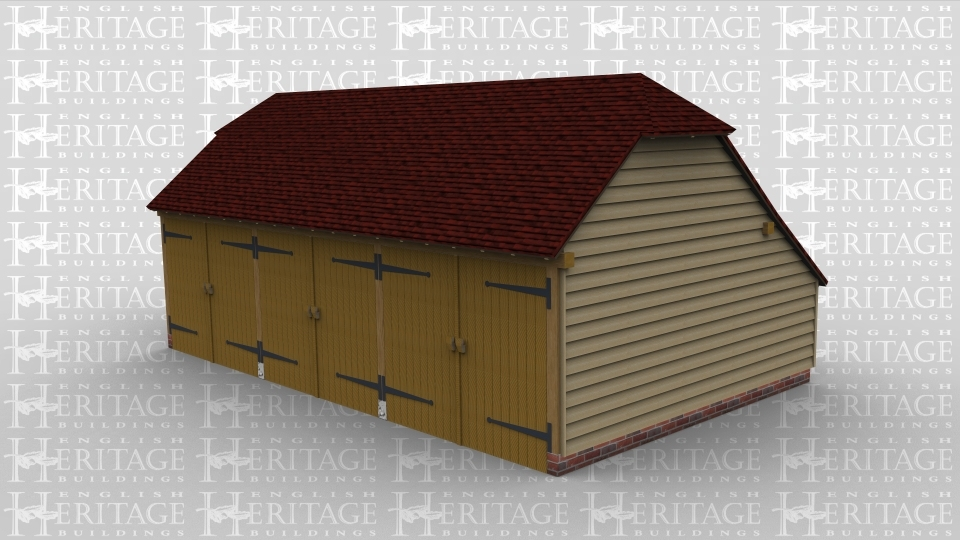A three bay oak framed garage with a set of garage doors on the front of each bay and barn hips on both the left and right side.