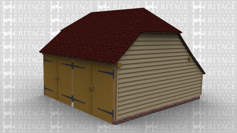 A two bay oak framed garage with each enclosed by a pair of garage doors at the front.