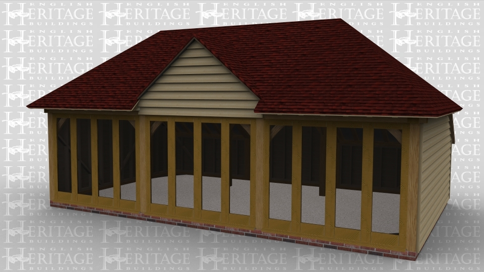 A three bay oak framed leisure building with full height glazing along the entire length of the front with a full hip roof on the left and right of the building and a barn entrance dormer on both the front and the back.