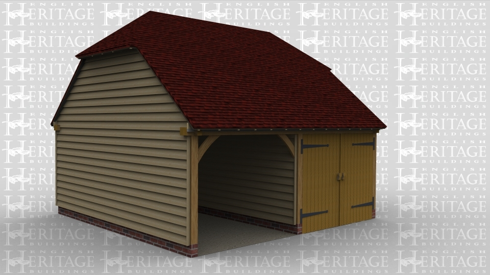 A two bay oak framed garage with one bay left open at the front while the other has a pair of garage doors at the front.