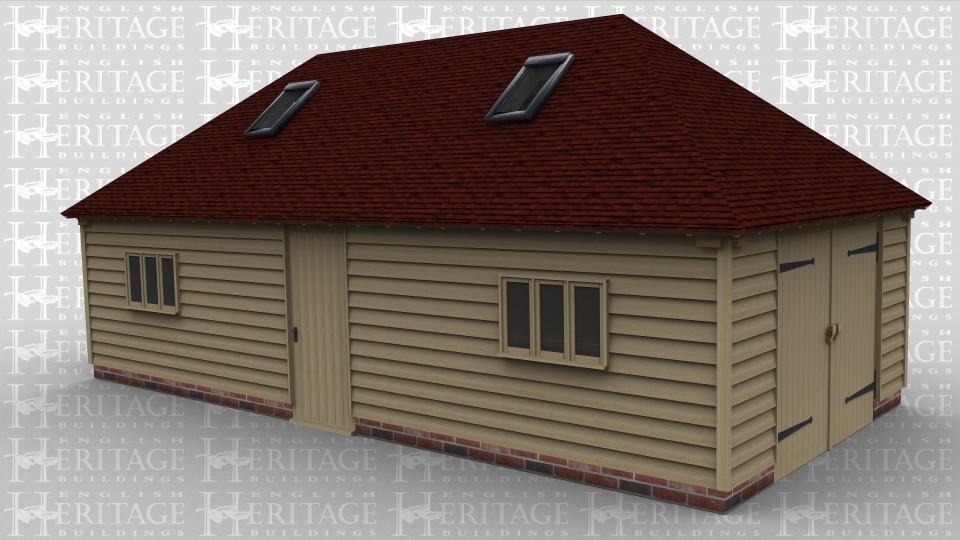 A 3 bay oak framed garage / workshop with two 3 light windows at the front as well as a single door while above there are 2 velux rooflights. On the right side of the building is a pair of garage doors.