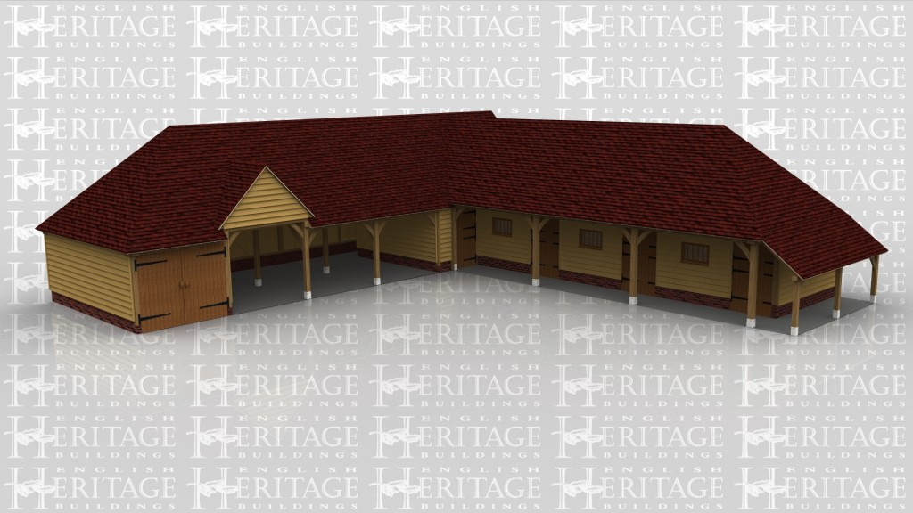 A 9 bay oak frame equestrian building made up of 2 frames. The first frame is 6 bays with an upper floor. On the ground floor one bay is enclosed with a pair of iroko garage doors and with 3 bays left open at the front and another bay enclosed with a solid single door while one of the open bays has a barn entrance, on the right of the building is an external oak staircase leading to the first floor with a solid single door . The second frame is 3 bays in size and has a mullion window and a functional stable door at the front of each bay with a covered walkway along the front and right hand sides.